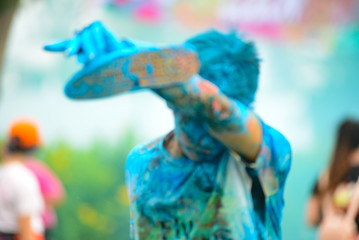 Ho Chi Minh City/ Vietnam - September 2017: Royalty high quality free stock photo of unidentified people are attending jogging festival with color powder. Color run event.