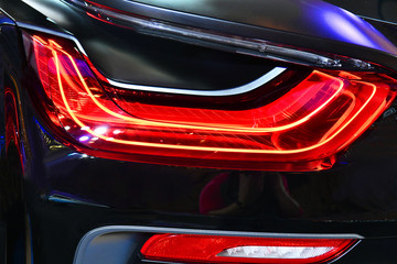Wall Mural - Close up car detail. New led taillight in hybrid sports car.