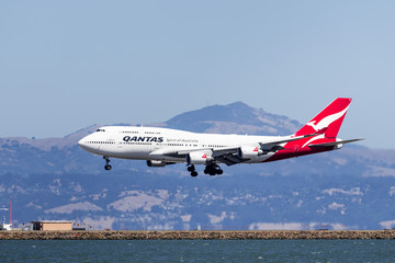 September 1, 2019 Burlingame / CA / USA - Qantas aircraft preparing for landing at San Francisco International Airport (SFO); Mount Diablo visible in the background