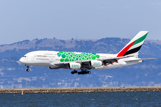 September 1, 2019 Burlingame / CA / USA - Emirates Airbus A380 aircraft with Expo 2020 Dubai livery landing at SFO; Green signifies the Sustainability theme;