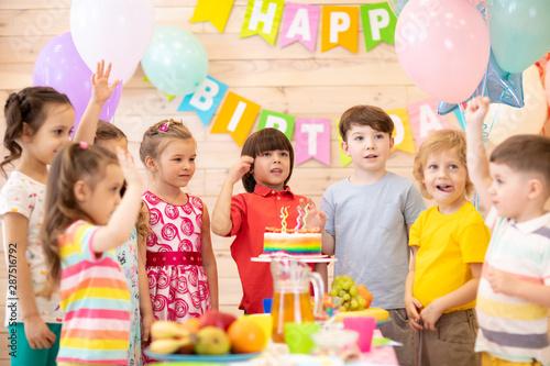 Group of preschool children having fun celebrating birthday