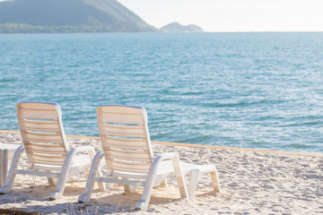 Fototapete - Beautiful beach. Chairs on the sandy beach near the sea. Summer holiday and vacation concept for tourism. Inspirational tropical landscape