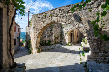 Wall Mural - old abandoned houses in town of Plomin, Croatia.