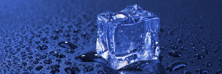 Blue single ice cube with water drops. Panoramic image