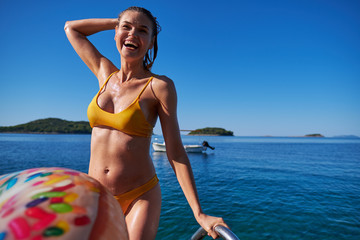 Portrait of beautiful woman on the sea Summer day background. Young woman outdoor