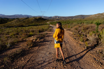 Young woman walking on rural trail