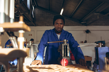 Portrait of young man working factory