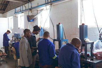 Men working in sports equipment factory