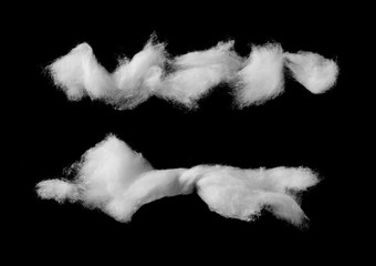 Wadding, absorbent cotton wool isolated on black background, top view
