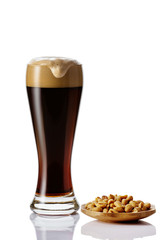 Perfect glass of dark beer with foam on white background