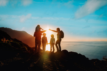 happy family with kids travel in mountains at sunset Wall mural