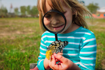 cute girl looking at butterfy, kids learning nature