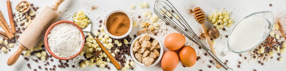 Keuken foto achterwand Bakkerij Ingredients for autumn winter festive baking - flour, brown sugar, eggs, chocolate drops, butter, cinnamon on stone or concrete background.Top view copy space.