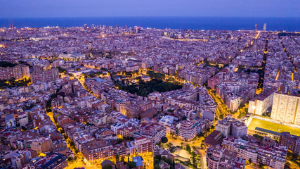 Aerial night Barcelona Spain. Night aerial top view photo. Beautiful night life from above. Catalonia capital