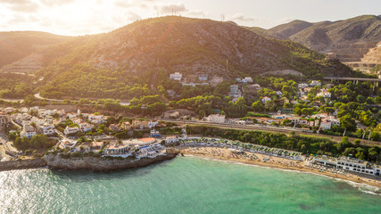 Beautiful Spain sunset. Garraf province of Barcelona, Catalonia, northern Spain. Beautiful view to the city from the sea. Aerial photo