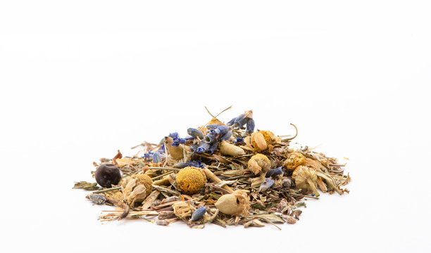 Dry herbal green tea with lavender, chamomile and mint on a white background, front view. Medicinal herbal tea.