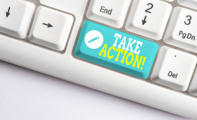 Handwriting text Take Action. Conceptual photo do something official or concerted to achieve aim with problem White pc keyboard with empty note paper above white background key copy space