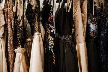Luxurious evening night out sparkling dresses hanging on the rack. High fashion concept, haute...