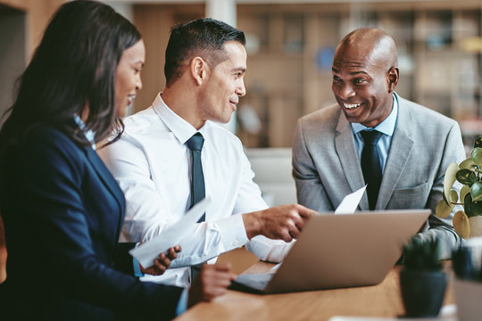 Smiling diverse businesspeople working together in a modern offi