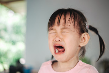 Emotional picture of crying and screaming kid. Concept of terrible two behavior, anger and tantrum in children.