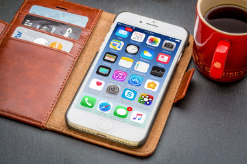 iPhone 7 in leather wallet with coffee