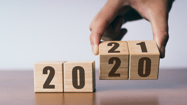 New year 2020 change to 2021 concept, hand change wooden cubes