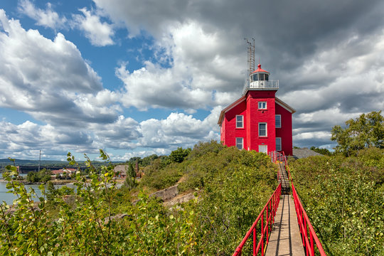 Marquette Harbor Lighthouse with catwalk on a sunny summer day