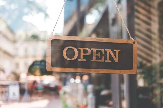 sign open on the door of the restaurant. open signboard