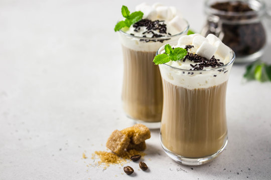Festive coffee with whipped cream, mint, marshmallow and chocolate. Selective focus, space for text.