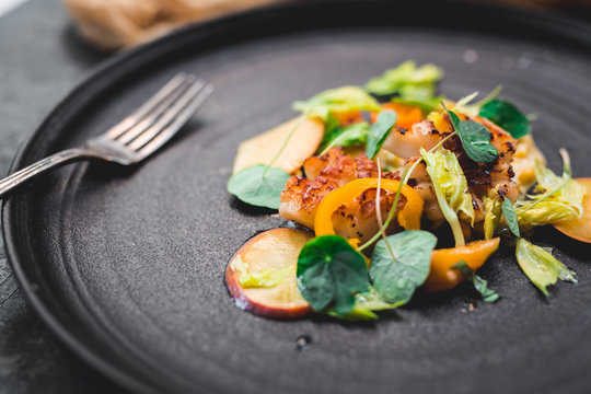 Grilled scallops, ripe and unripe peach, nasturtium leaves, celery