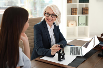 Female notary working with client in office