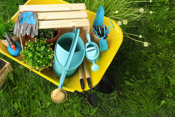Composition with gardening tools on green grass, above view