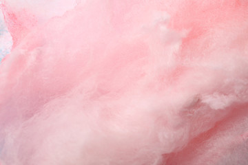 Sweet pink cotton candy as background, closeup view