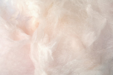 Sweet light cotton candy as background, closeup view