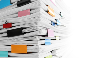 Stack of documents with colorful binder clips, closeup