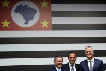Andrade, CAOA's president and founder, Sao Paulo state Governor Doria and Watters, South America president of Ford Motor Company pose for pictures after a news conference in Sao Paulo
