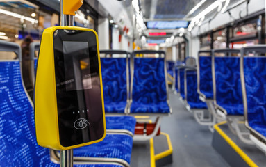 Modern touch payment terminal in bus. Terminal of payment for travel by transport or bank cards. Public city passenger transport