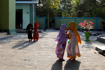 Muslim children react as they play outside a mosque in North Penajam Paser regency