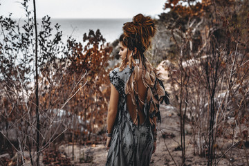 Foto op Aluminium People portrait of beautiful young woman through the dry branches outdoors