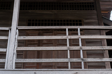 Antique old wooden balcony of rural house in Thailand