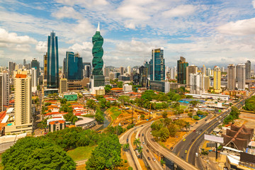Fotomurales - The cityscape of Panama city with its most famous skyscrapers in the financial district at sunrise with the morning traffic on the highway, Panama, Central America.