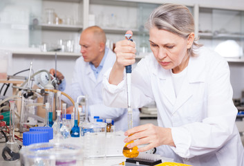 Female scientist working with reagents