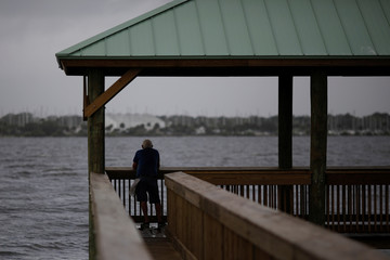 A man looks at Indian River at Parrish Park ahead of the arrival of Hurricane Dorian in Titusville