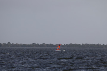A windsurfer practices at Indian River ahead of the arrival of Hurricane Dorian in Titusville