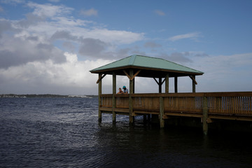 A couple look at Indian River at Parrish Park ahead of the arrival of Hurricane Dorian in Titusville