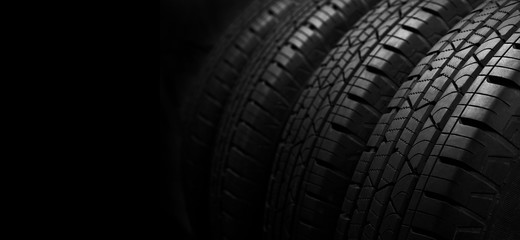 Studio shot of a set of summer car tires on black background with copy space.