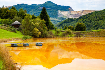nature pollution from copper mine at lake Geamana, Romania Wall mural