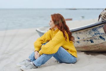 Casual young woman enjoying a misty autumn beach