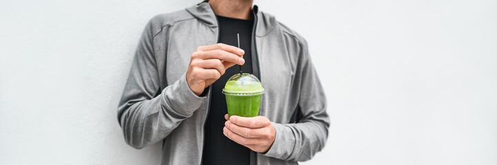 Green juice detox drink healthy man drinking green smoothie cup protein shake panoramic banner....