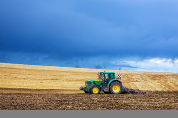 John Deer tractor tilling the soil with disc harrow, Germany, Lower Saxony, August 2013